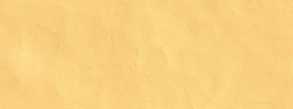 Vintage Grunge Light yellow plaster Wall Background