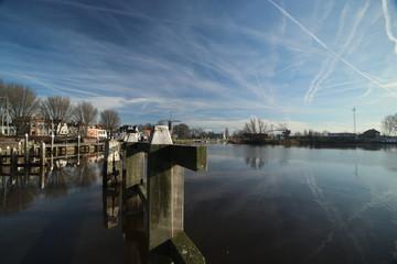 Oude Veerstal along the quay of river hollandsche IJssel in Gouda The Netherlands