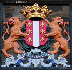 Crest of the city of gouda on building at the Lange tiendeweg in the Netherlands