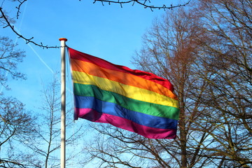 Rainbow flag waving in the wind in the city of Gouda for more respect for LBHTI