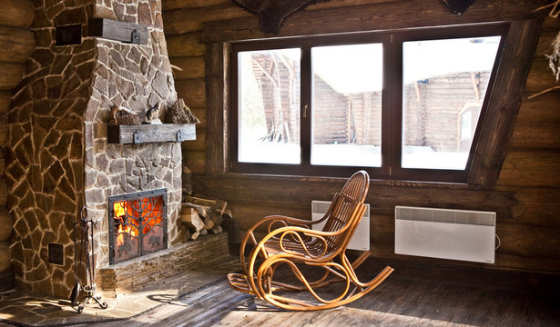 country style interior in hunter chalet with fireplace