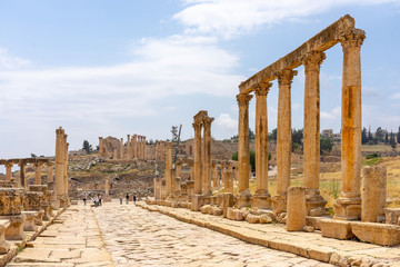 Cardo Maximus, main colonnaded street of the Roman city of Jerash, Jordan. Zeuss temple on background