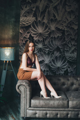 Beautiful woman in a skirt in a beautiful interior. Toning