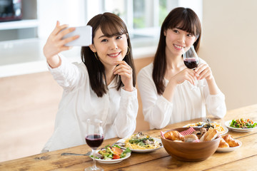 attractive asian women enjoying home party