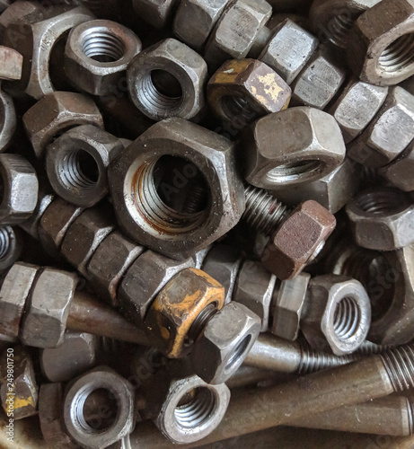 Many small and large bolts, nuts  rusty and dirty  view from