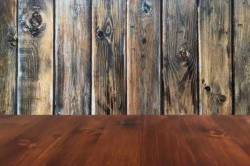 old brown oak wooden table on the blurry wood wall background, wood table.