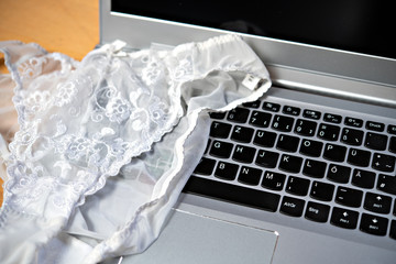 white woman panties with laptop- computer
