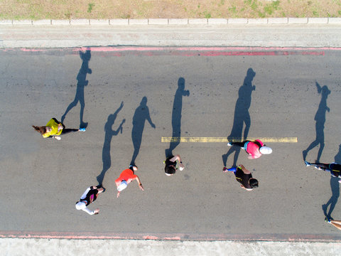 aerial view of marathon runners on the road