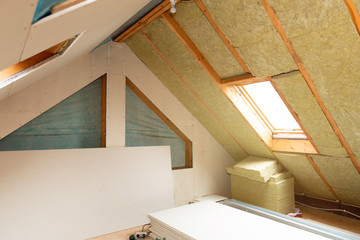 Obraz House attic insulation and renovation. Drywall construction - fototapety do salonu