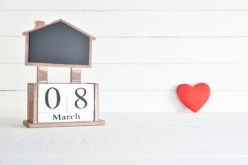 Womens day concept, happy womens day, international womens day. March 8 text wooden block calendar with red heart on white wooden background.