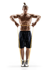 Muscular man performs exercises using a resistance band. Photo of young man isolated on white background. Strength and motivation. Full length