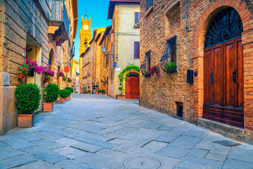 Rustic brick and stone houses decorated with colorful flowers, Italy