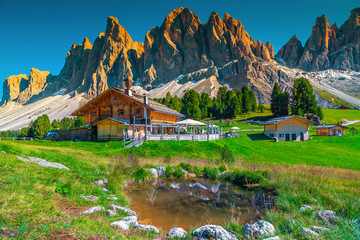 Wall Mural - Cozy alpine chalets with mountain lake in Dolomites, Italy, Europe
