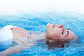Girl relaxing in swimming pool