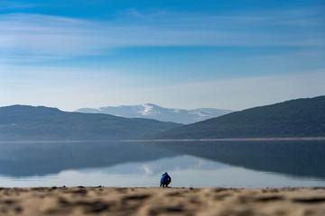 Person at a mountain beach