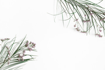Flowers composition. Dried flowers and leaves on white background. Flat lay, top view, copy space