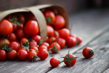 rustic basket of tomato fresh on wood