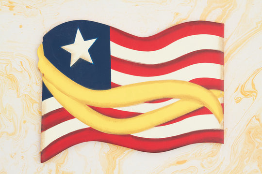 Retro wood American flag with a yellow ribbon