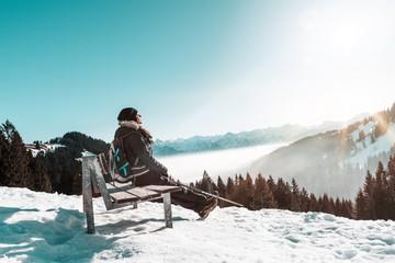 woman enjoying the sun in winter landscape