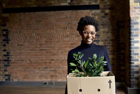 Portrait of a black African businesswoman starting a new job