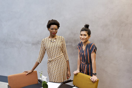 Portrait of black African businesswoman and Asian female professional colleague