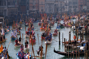 People watch a water parade marking the beginning of carnival season, along the Grand Canal in Venice