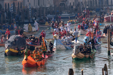 People watch a water parade marking the beginning of carnival season, along the Rio di Cannaregio canal in Venice