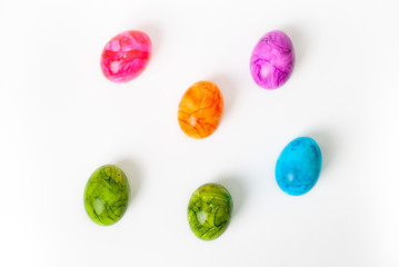 Colorful painted easter eggs laying on white background