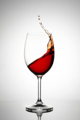 Splashing wine in a glass
