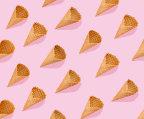Creative layout - pattern made with ice cream cones, top view