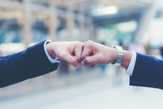 Close up hands businessman and partner working of business people join hand together and start up work. Teamwork Concept