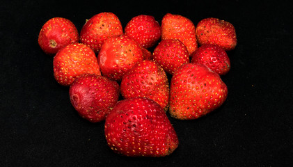 strawberry on black background - healthy fruit