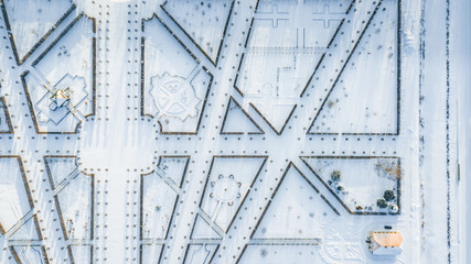 Aerial view of Rundale palace and baroque garden covered in snow at a sunny winter's day. Unique maze type french garden creates symmetrical view with different type of shapes. Pictures