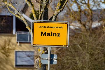 "Traffic road sign of the german city mainz with german lettering ""landeshauptstadt berlin"" means capital city berlin"