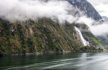 Low, hanging cloud at Bowen Falls in Milford Sound, Fiordland National Park, South Island, New Zealand
