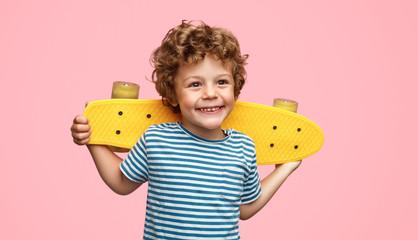 Cheerful boy with skateboard