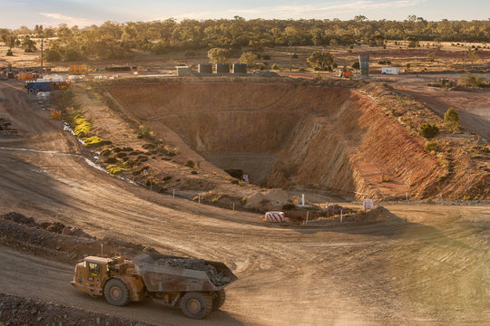 Truck laden with ore leaving a mine tunnel at a copper mine in NSW, Australia