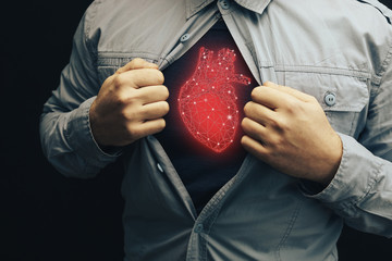 Business man in shirt with a picture neon red heart innovative technologies.