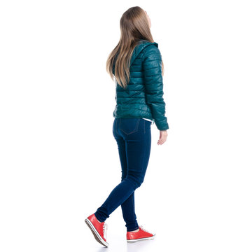 Woman in jeans and jacket walking goes looking on white background. Isolation, back view