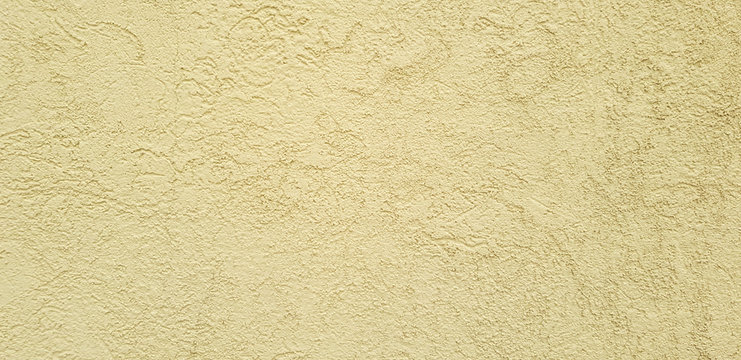 Brown concrete wall with rough texture pattern