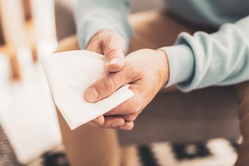 Depressed man holding napkin in hands