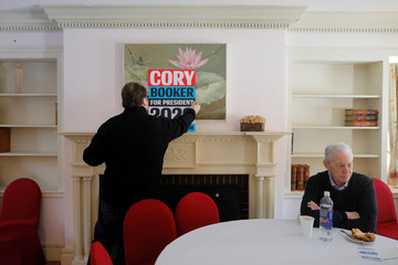 A volunteer places a poster for Democratic 2020 U.S. presidential candidate and U.S. Senator Cory Booker at a campaign stop in Rochester