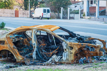 Close-up passenger car involved in accident on the road and burned after crash