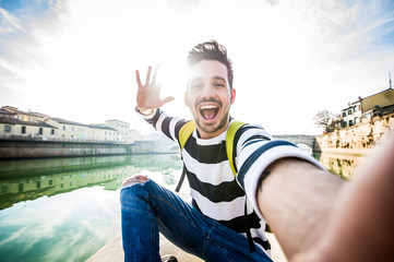 Caucasian man taking an urban selfie