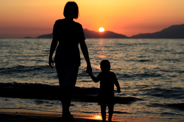 mother and child on sunset