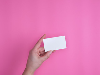 empty white rectangular business card in a female hand