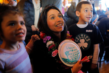 Democratic 2020 U.S. presidential candidate Gabbard poses for a photograph with Akira and Jackson Hobert in Portsmouth