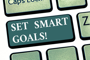 Handwriting text Set Smart Goals. Concept meaning Establish achievable objectives Make good business plans Keyboard key Intention to create computer message pressing keypad idea