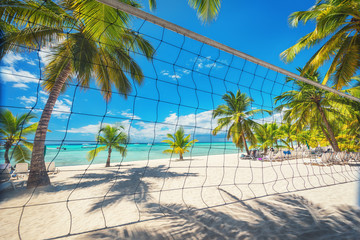 Volleyball net on tropical beach and Caribbean sea. Punta Cana, Dominican Republic.