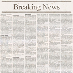 Newspaper with headline Breaking News and old unreadable text